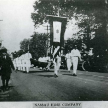 Parade welcoming home servicemen from WWI. Main Street, Port Washington, N.Y.